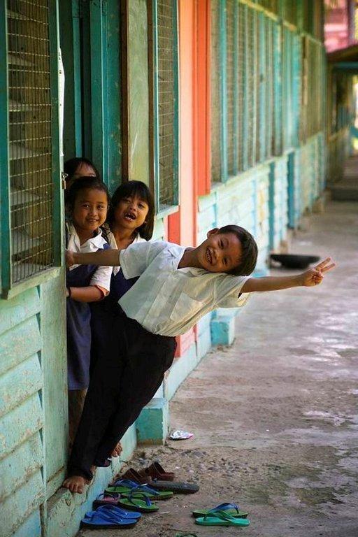 Ihmisten kuvaaminen on yksi matkakuvaamisen parhaita puolia. Varsinkin lapset jaksavat aina poseerata.