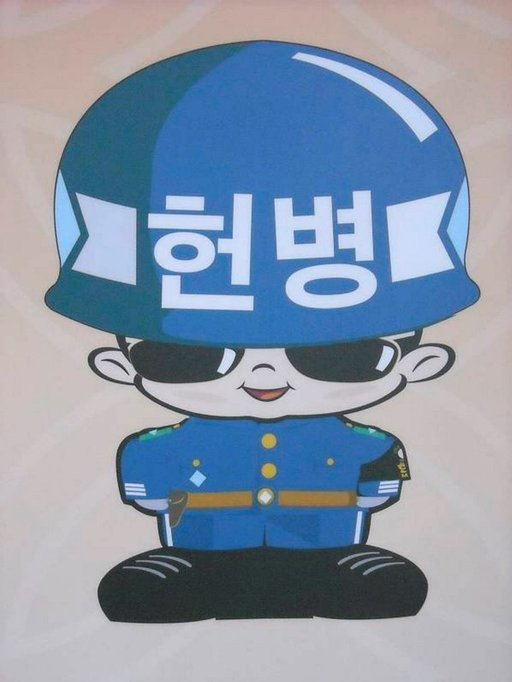 Eteläkorealaisella sotilaalla on aurinkolasit.